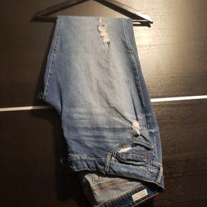 Distressed lighter/medium wash jeans